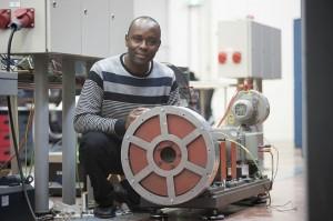 Photo: Dr. Sam Ani with his low-cost self-built generator – Photo: Tomas van Dijk